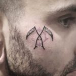 Crossed Scythes Tattoo on Face by mewo llama
