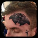 Dark Moth Tattoo on Face