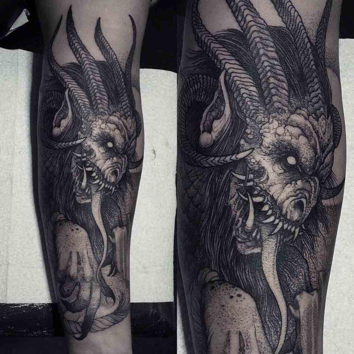 forearm tattoo demon