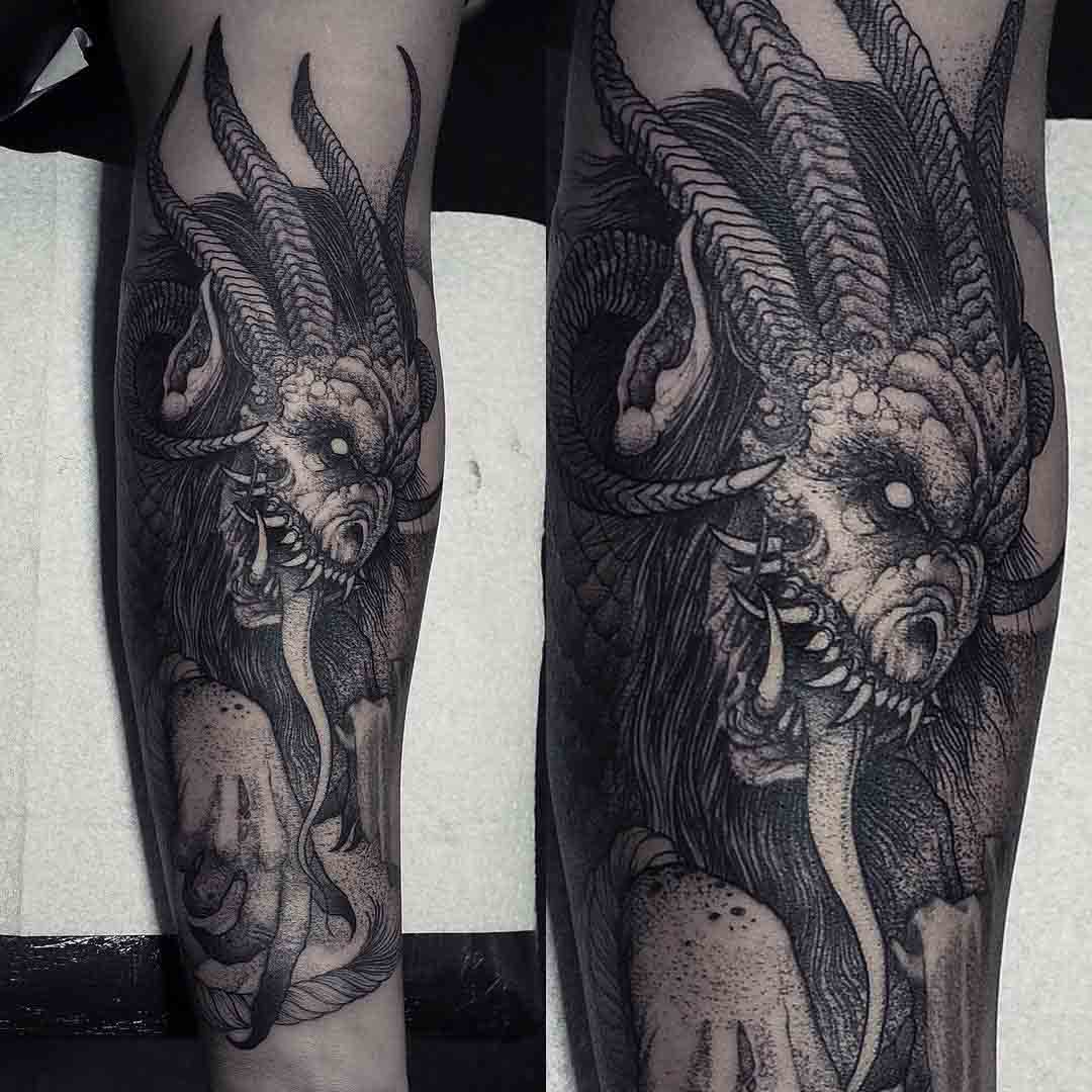 forearm tattoo demon