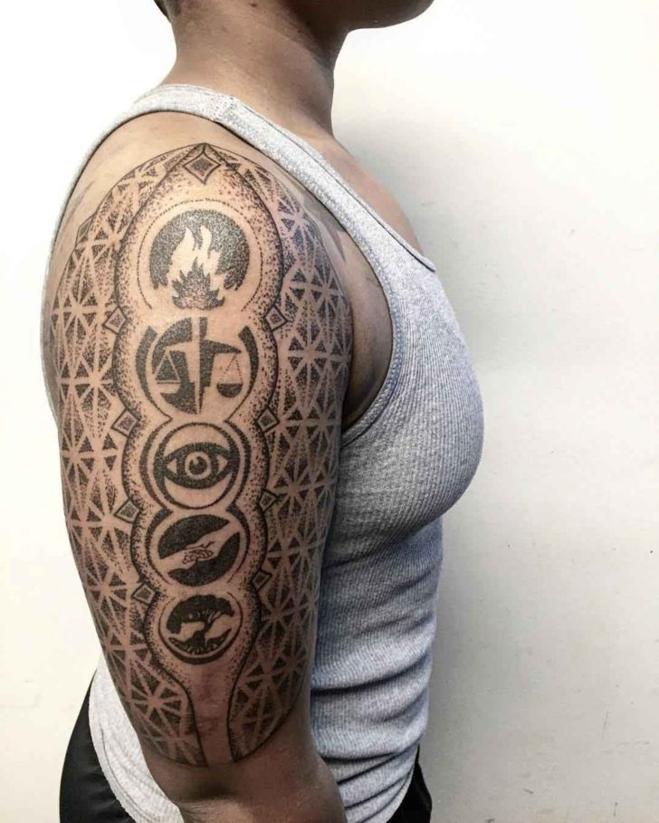 divergent faction symbols tattoo dotwork on shoulder