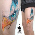 thigh tattoo eagle eye feather
