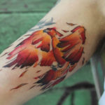 bicep tattoo firebird