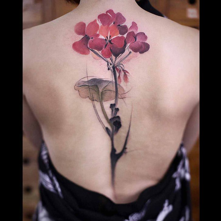 back watercolor floral tattoo