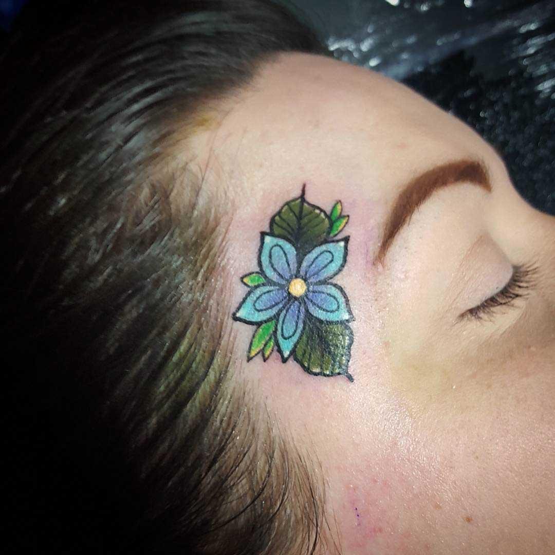 Flower Face Tattoo by Paula Castle