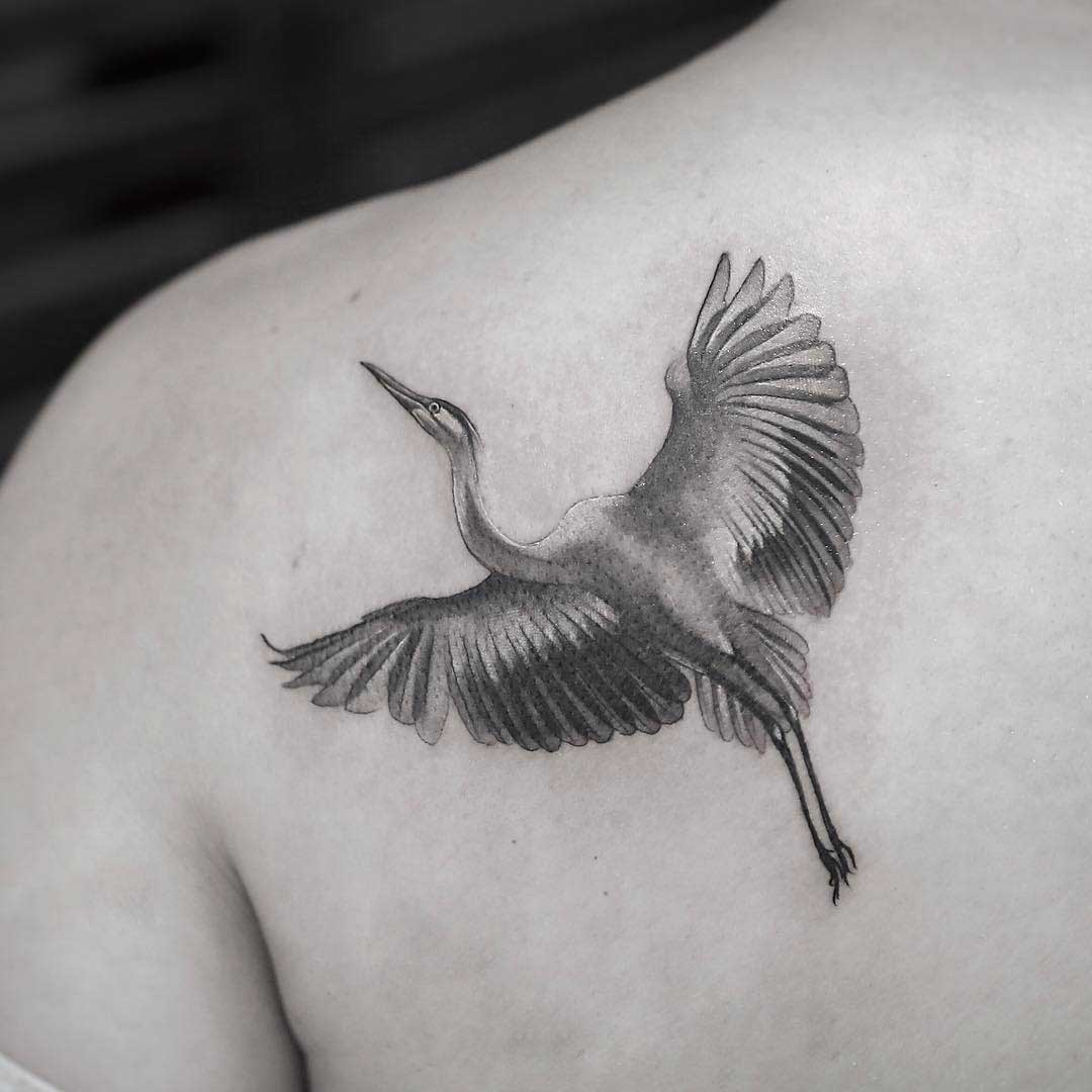 shoulder blade tattoo crane