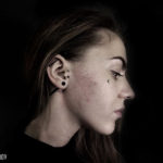 Girl With Face Tattoo by Ilya Anisimov
