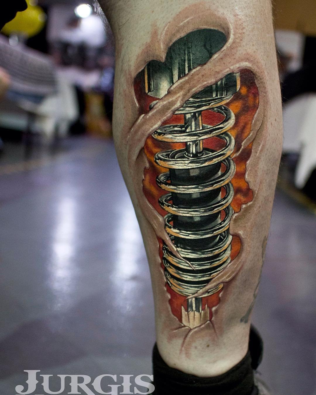 cool piston tattoo on leg by Jurgis Mikalauskas
