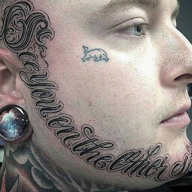Lettering Tattoo Around The Face by porkydukecityink