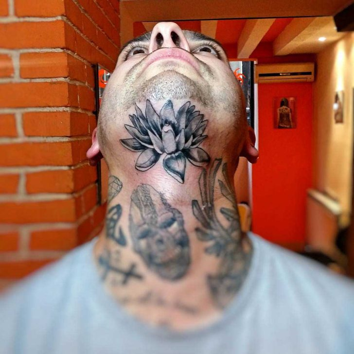 Lotus Chin Tattoo by miskotattoo