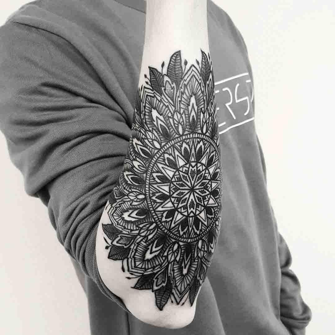 outer forearm tattoo mandala