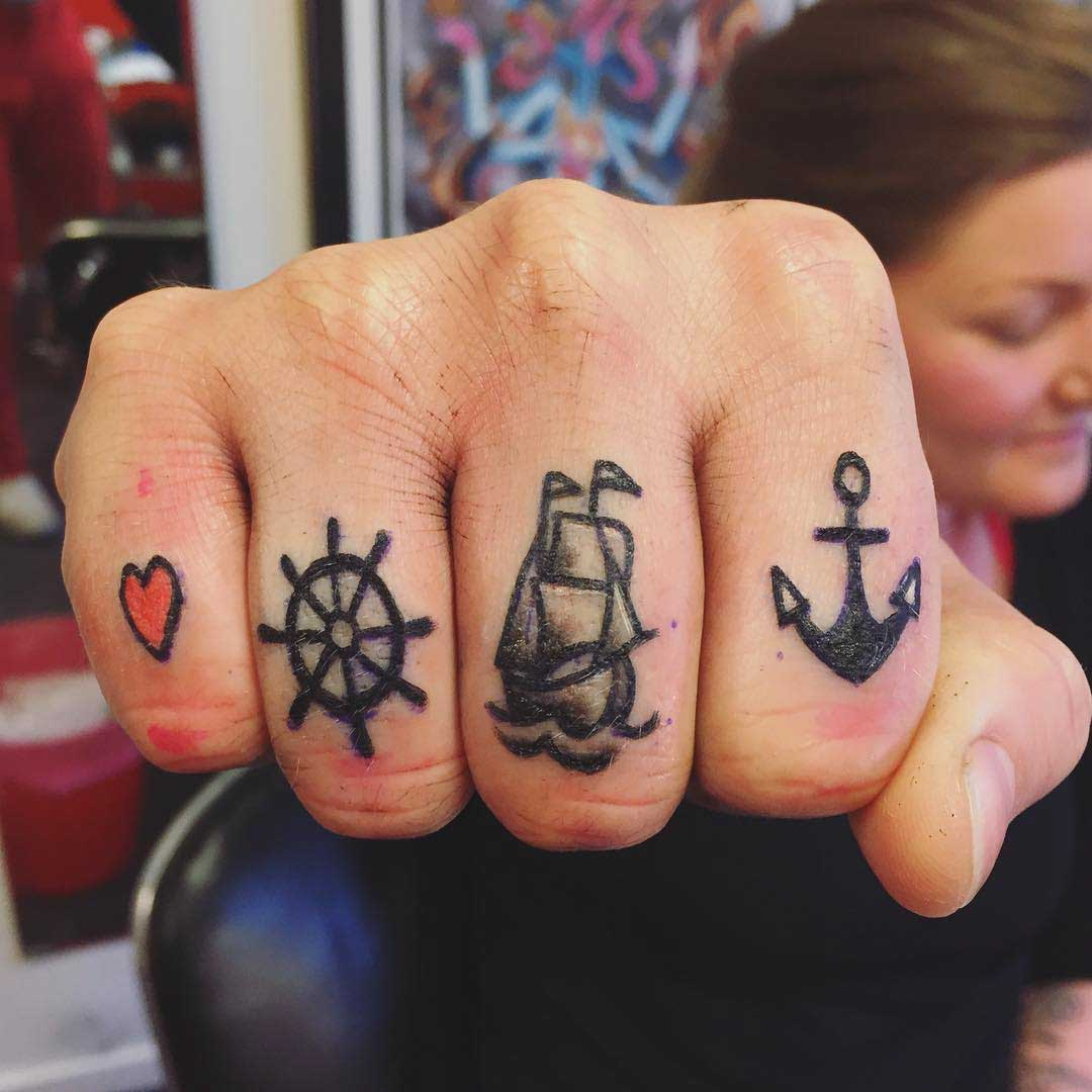 nautical themed tattoos on fingers