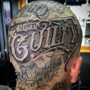 Not Guilty Head Tattoo