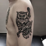 shoulder tattoo of owl with key dotwork style