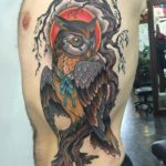 owl on a branch tattoo on the torso side