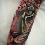 animalistic sleeve tattoo puma face