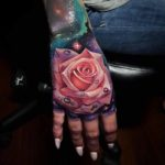 Pink Rose Hand Tattoo