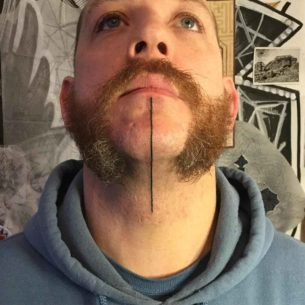 Single Line Tattoo on Chin
