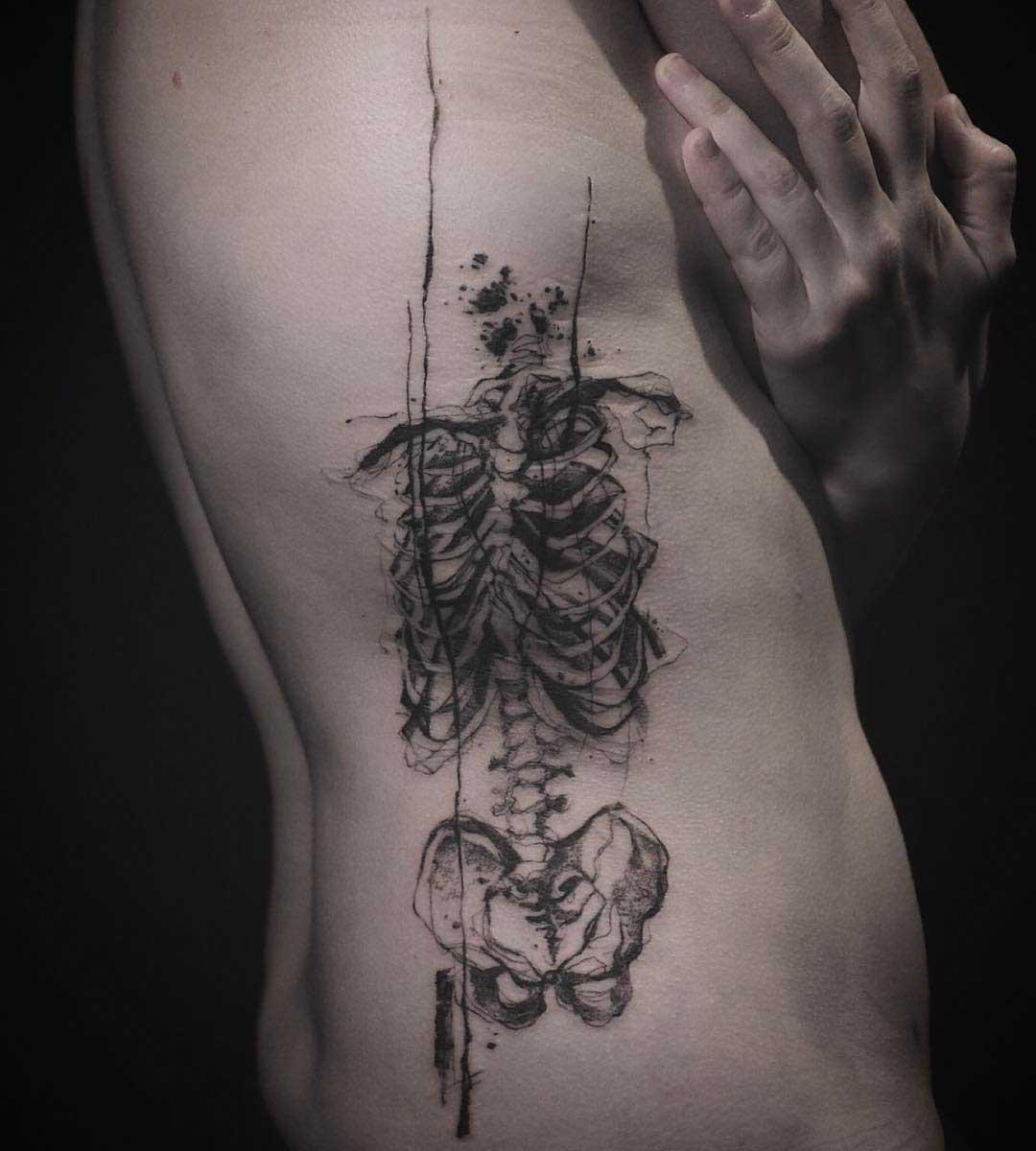 pencil drawn skeleton tattoo on ribs