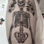 shoulder skeleton tattoo with flowers