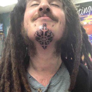 Snowflake Tattoo Under Chin