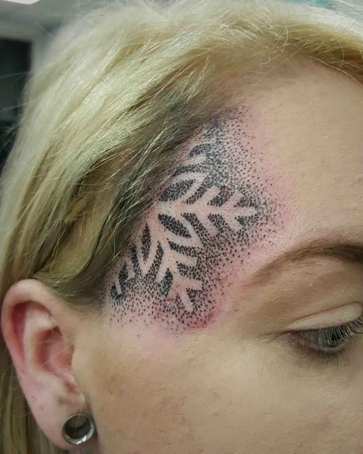 Snowflake Tattoo on The Face Side by Lynden Chadwick