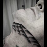 Spider Web Tattoo Under Chin