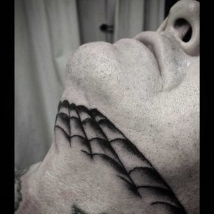 Spider Web Tattoo Under Chin