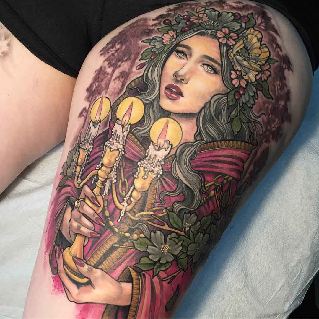 spring impersonation tattoo on thigh