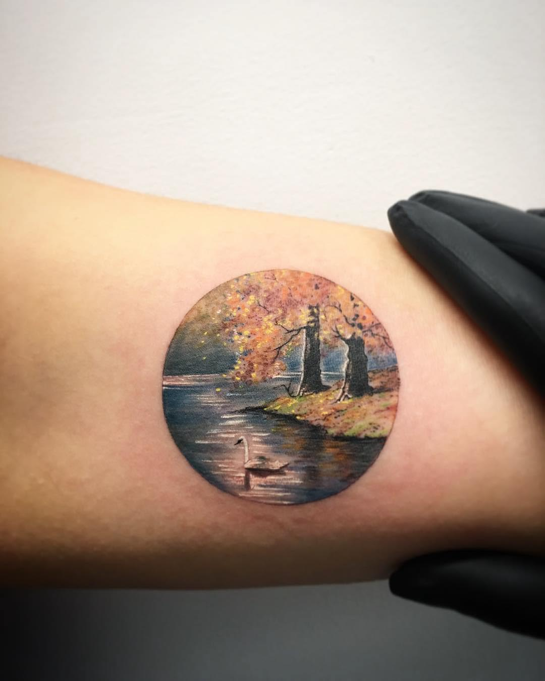 arm tattoo landscape circle-shaped