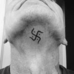 Swastika Tattoo Under The Chin