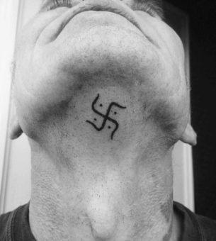 Swastika Tattoo Under The Chin