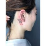 feminine tattoo behind ear