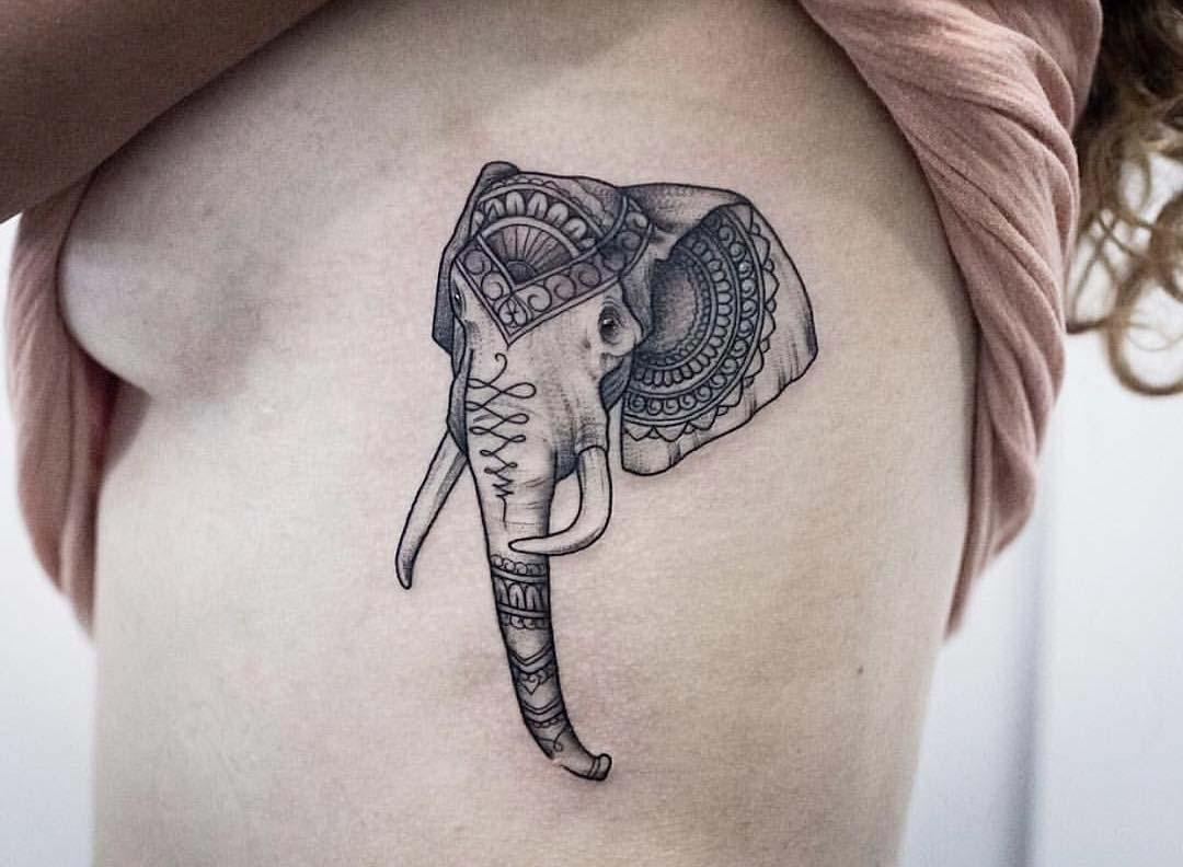 ribs tattoo elephant head