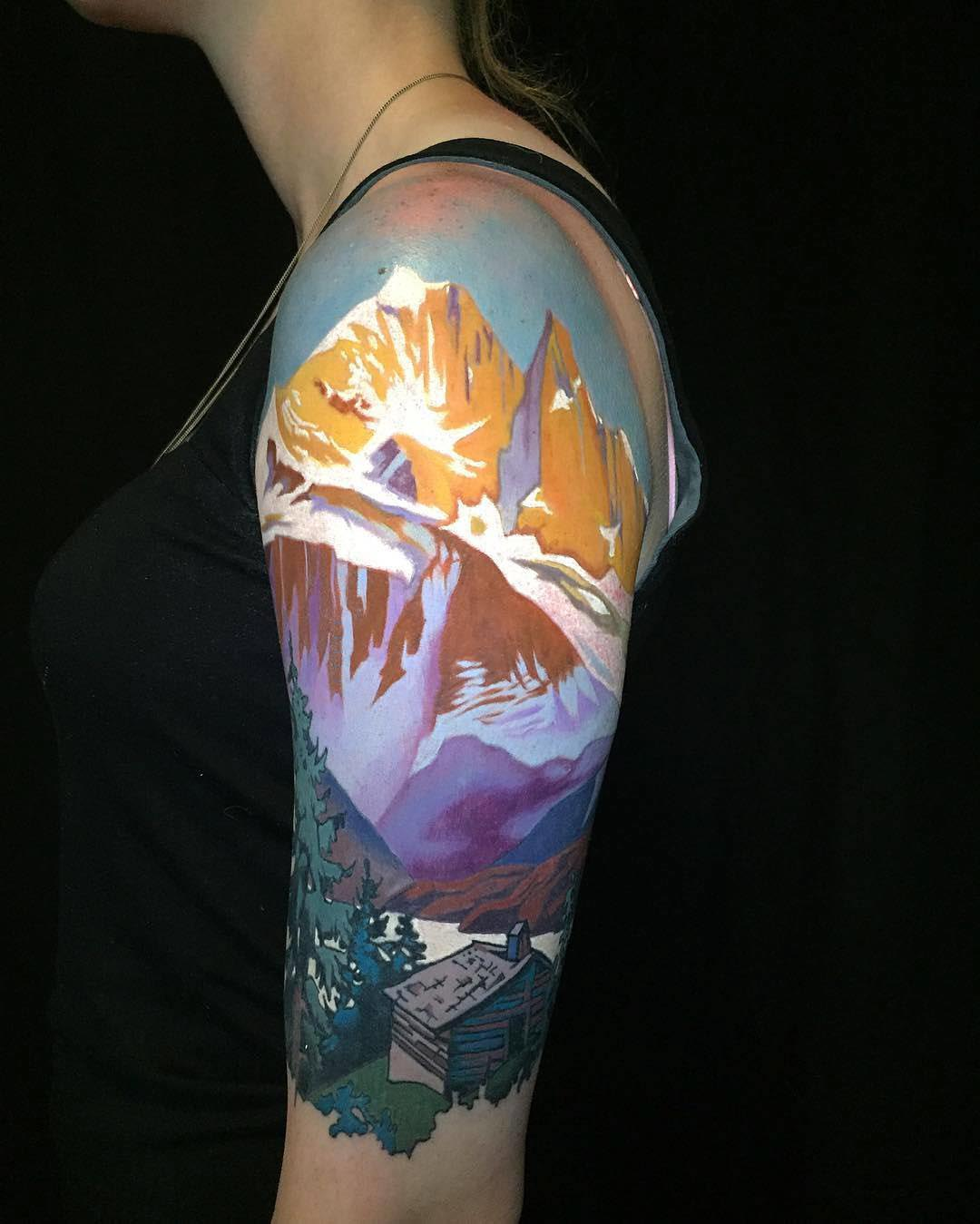 mountains tattoo on shoulder