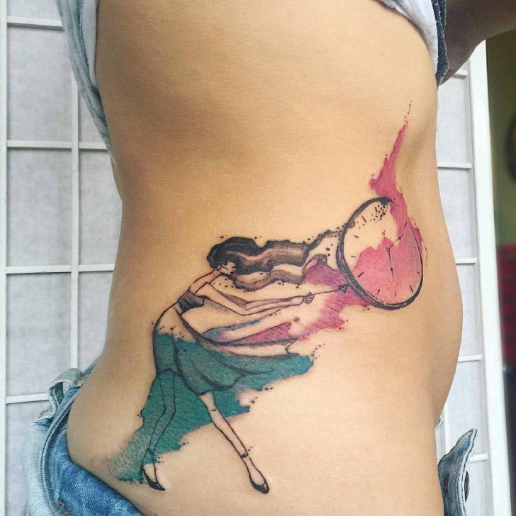 watercolor stomach side tattoo girl