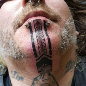 Tattoos on Chin