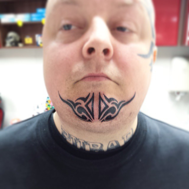 Tribal Chin Tattoo by madprof666
