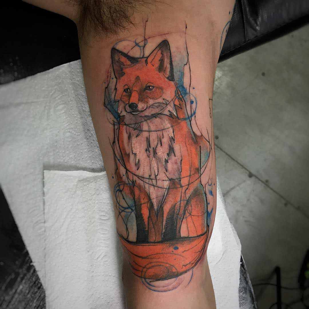 fox tattoo on bicep