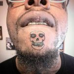 Weird Skull Tattoo on Chin