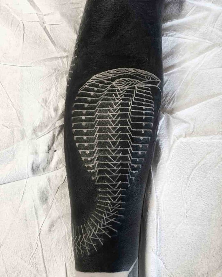 white tattoo snake on arm