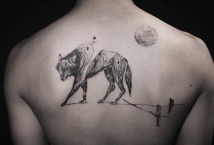 awesome wolf tattoo on back