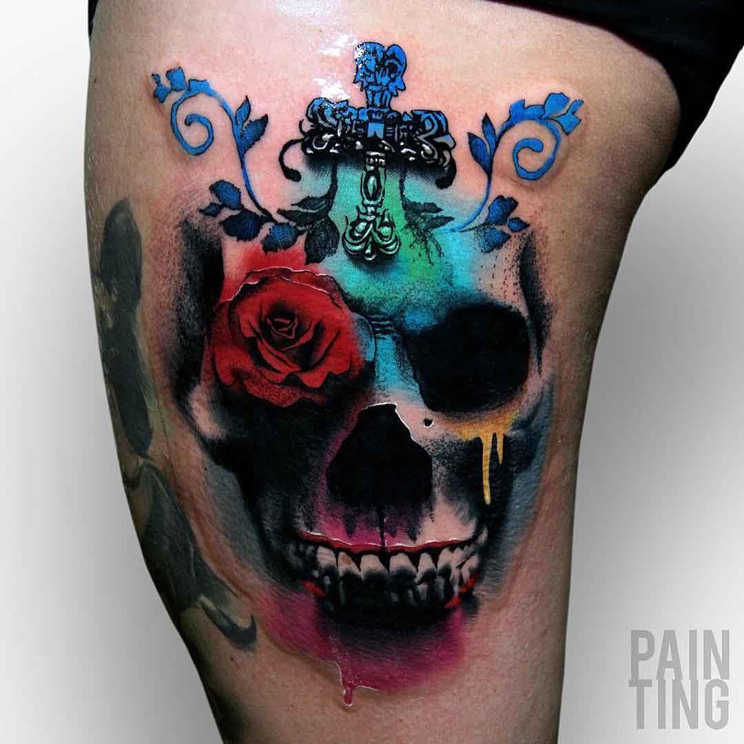 colorful skull tattoo on hip