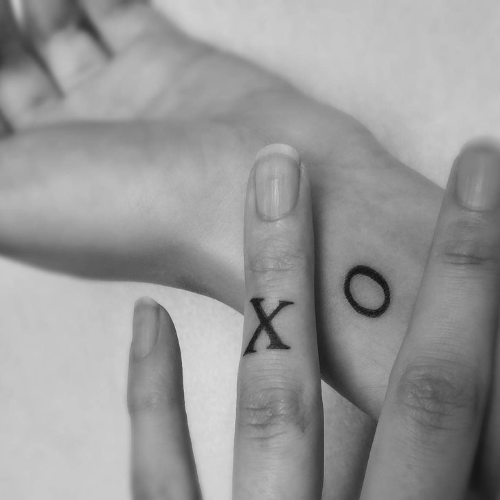 X O Tattoos for Sisters on Wrist and Finger