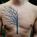 black and white tree tattoo on chest
