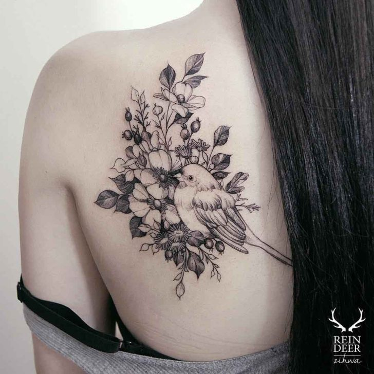 flowers and bird tattoo on shoulder blade for girls