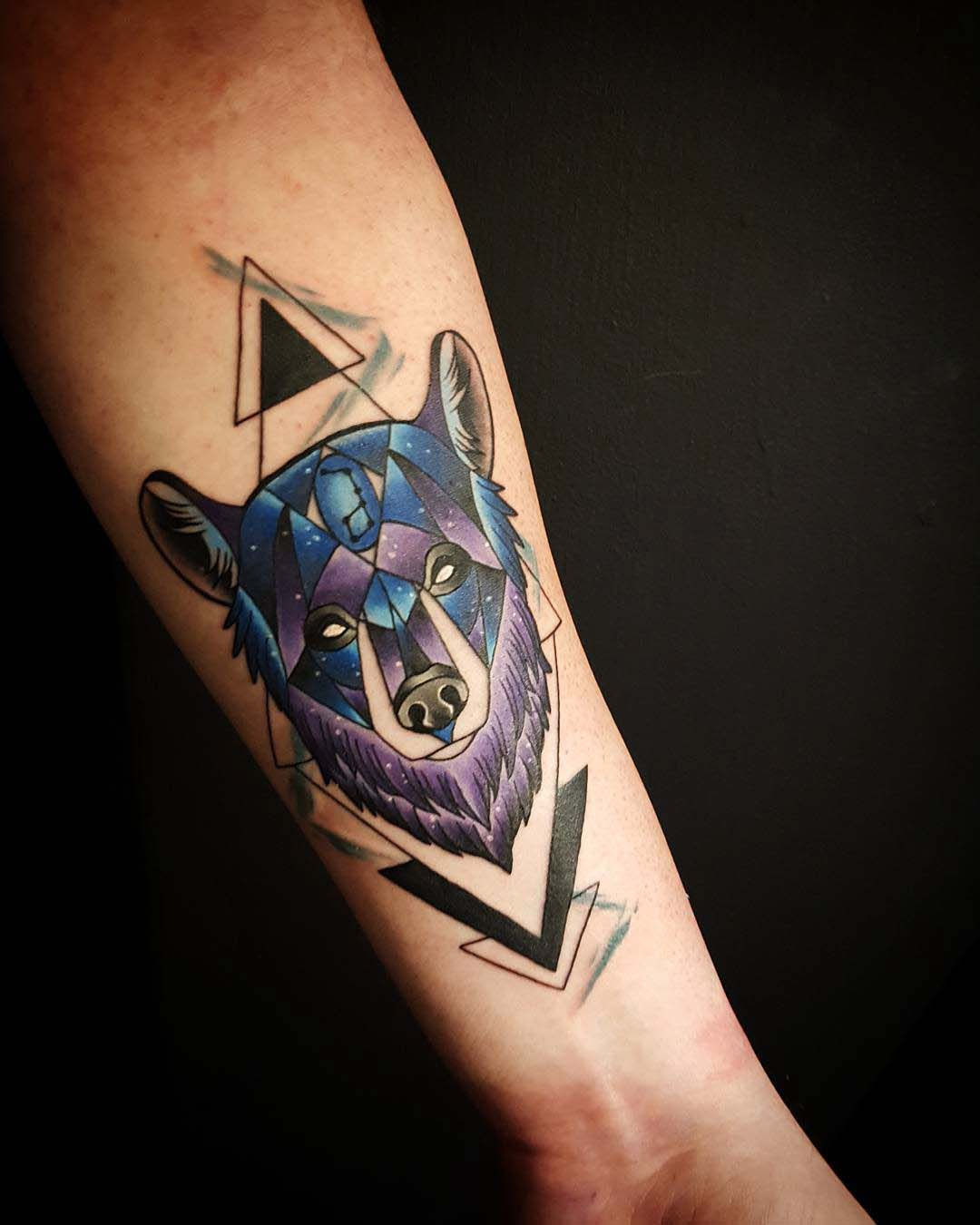 arm tattoo bear face