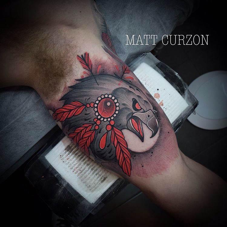 hawk tattoo on bicep