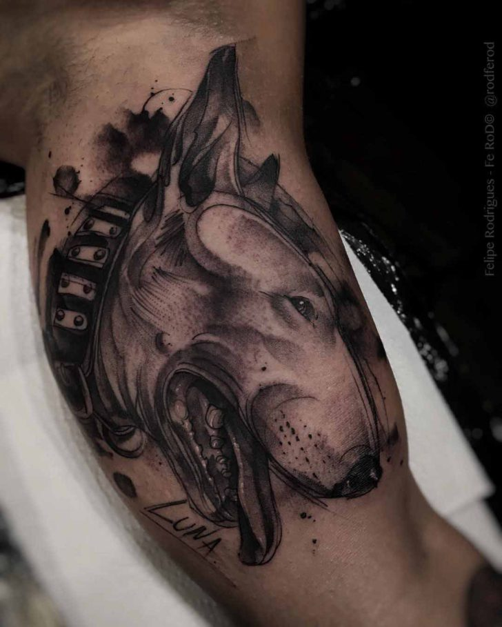 dog tattoo on bicep
