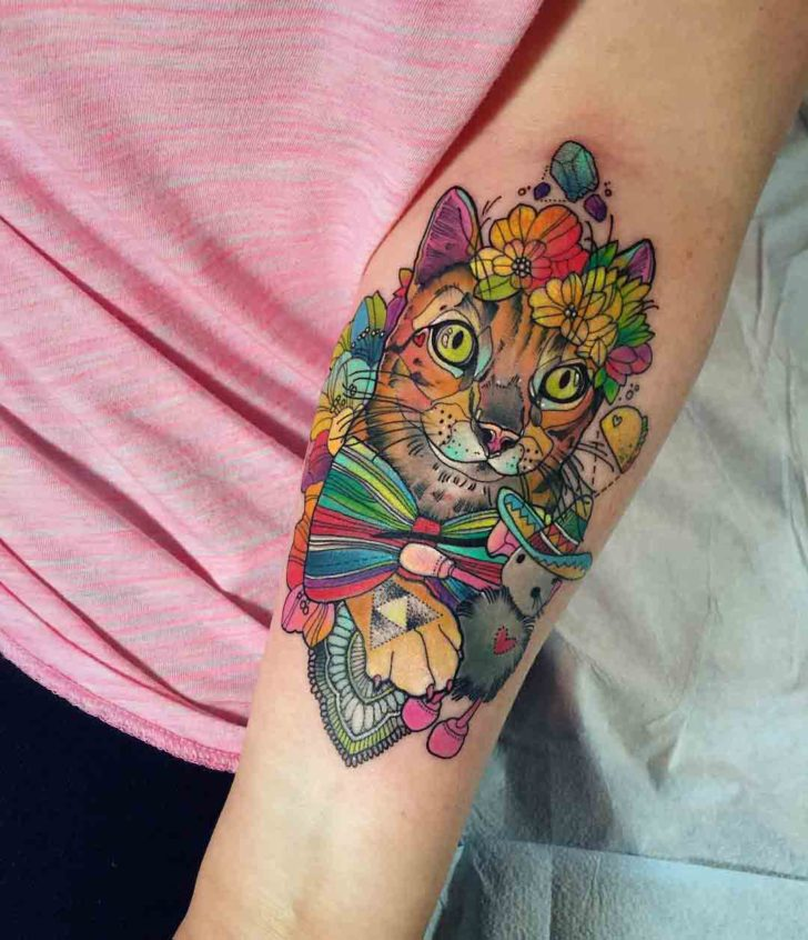 flowers cat tattoo on inner elbow
